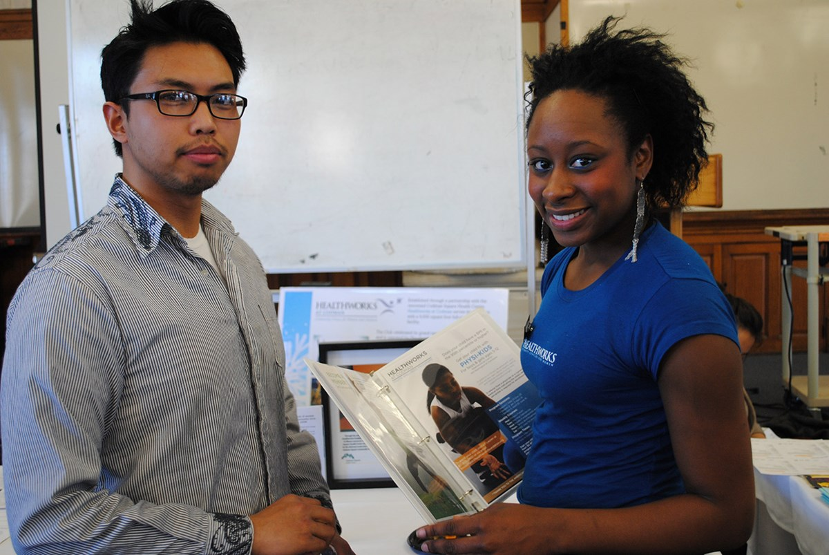 UMass Lowell students Jimmy Le and Sabrina Lozandieu pose for a picture at an internship fair.