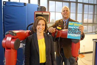 Beth Humberd and Scott Latham pose with a robot at the NERVE Center