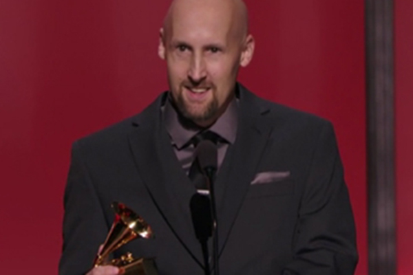 A 'shocked' Joel Plante clutches his Grammy Award while addressing the press in Los Angeles.