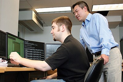 Assoc. Prof. Yan Luo with student in the lab