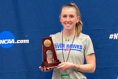 Kaley Richards holds her indoor track All-American award
