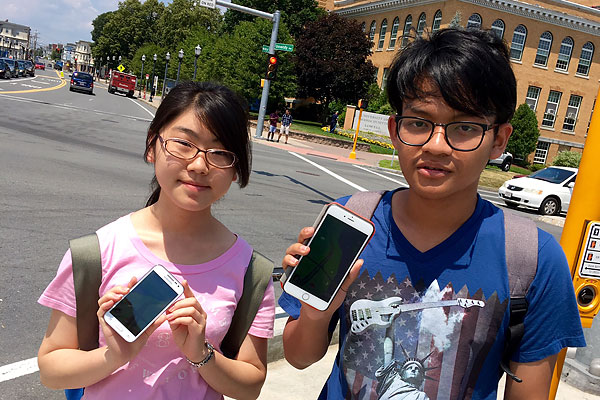 "The Pokémon GO craze has invaded the UMass Lowell campus. Rin Kawaguchi, left, a peace and conflict studies student, and Thu Ta Soe, a mechanical engineering major, say the game makes them ""get up and explore the university and the City of Lowell."""