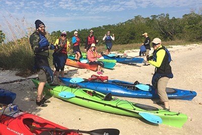 Students on sea kayaking and camping trip to Florida
