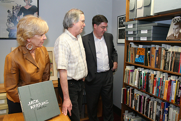 Janine Whitcomb, left, Brad MacGowan, center, and Mehmed Ali check out the Beat literature collection at the new Kerouac Room at the UMass Lowell Center for Lowell History.