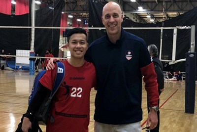 Jackie Kho with national team coach John Speraw