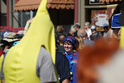 Team member Jacqui Gallant and a man in a banana costume wait for the race to start