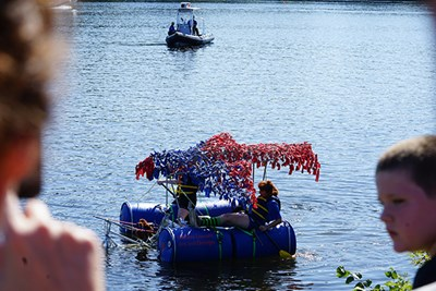 The Rowdy River Rovers paddle in the Merrimack River
