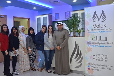Devon White with Hesham Alebrahim and the staff of Malak Special Needs Services in Kuwait City
