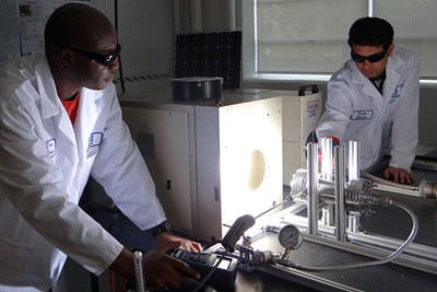Students work with the solar simulator in the lab