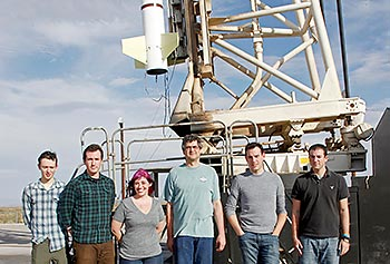 Asst. Prof. Timothy Cook, fourth from left, poses with his team at the White Sands Missile Range in New Mexico: Ewan Douglas, Brian Hicks, Meredith Danowski and Chris Mendillo and Jason Martel.