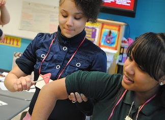 Lawrence High School students participate in a nursing workshop. Nursing received a $996,584 grant to recruit, retain and graduate nurses from diverse backgrounds.