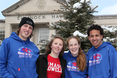Students standing in front of Cumnock Hall on a snowy day