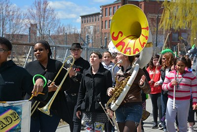 Students march in 2015 Lowell Earth Day Parade