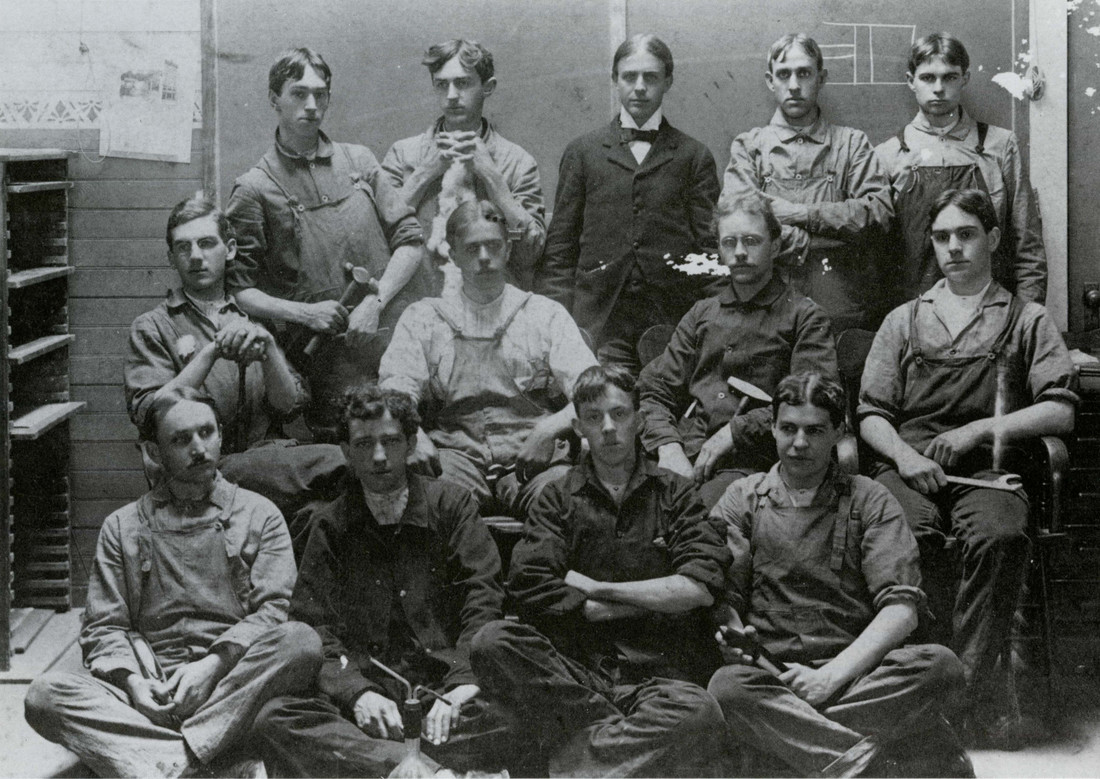 Lowell Textile School's class of 1900 held the wrenches and hammers that were common in the textile industry