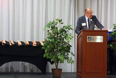 Jeffrey Mead speaks during the hooding ceremony