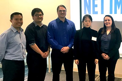 The grad students on the case competition team with Assoc. Prof. Julie Zhang
