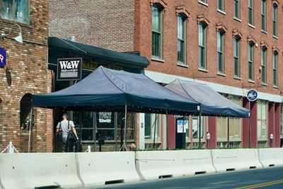 The outdoor seating area in front of the Warp and Weft restaurant