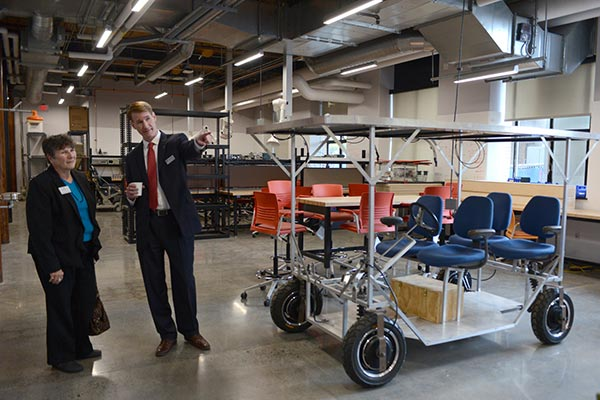 Joseph Hartman, dean of UMass Lowell's Francis College of Engineering, provides a tour of the college's new makerspace to Lisa Derby Oden, project manager of the Massachusetts Manufacturing Extension Partnership.