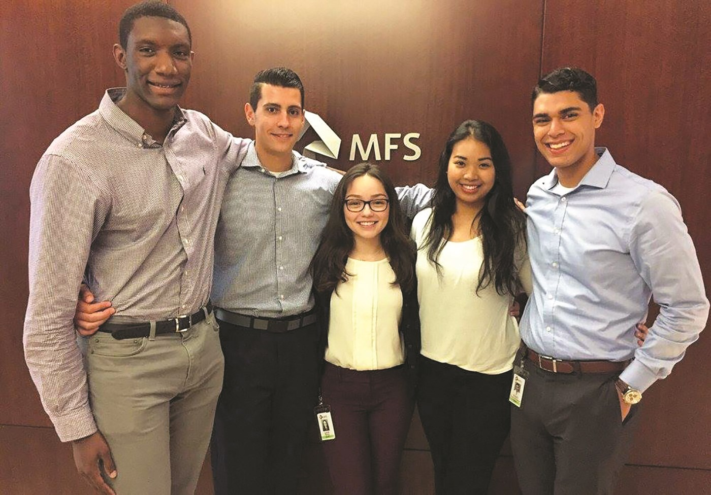 UMass Lowell junior finance and economics major Linda Barg (center), identity management co-op at MFS Investment Management