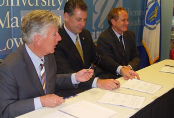 Chancellor Meehan, Sheriff Peter Koutoujian and Prof. James Byrne sign partnership agreement for research.