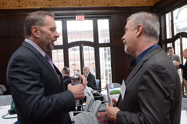 Gary Wallace, executive director of the Lowell Housing Authority, talks with Assoc. Prof. Thomas Pineros-Shields, head of the new M.P.A. program, at the launch event.