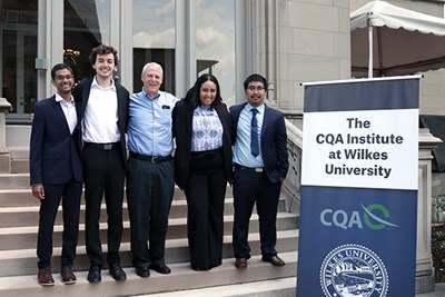 Manning students pose with Ed Keon at the CQA Institute