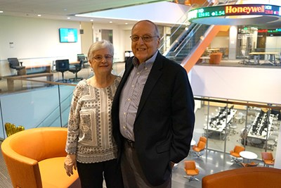 Alum Ron Cannistraro and his wife Carol pose in the new business school