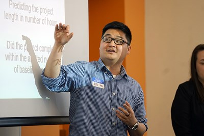 MSBA grad student Tri Mai explains his capstone project with MFS Investments