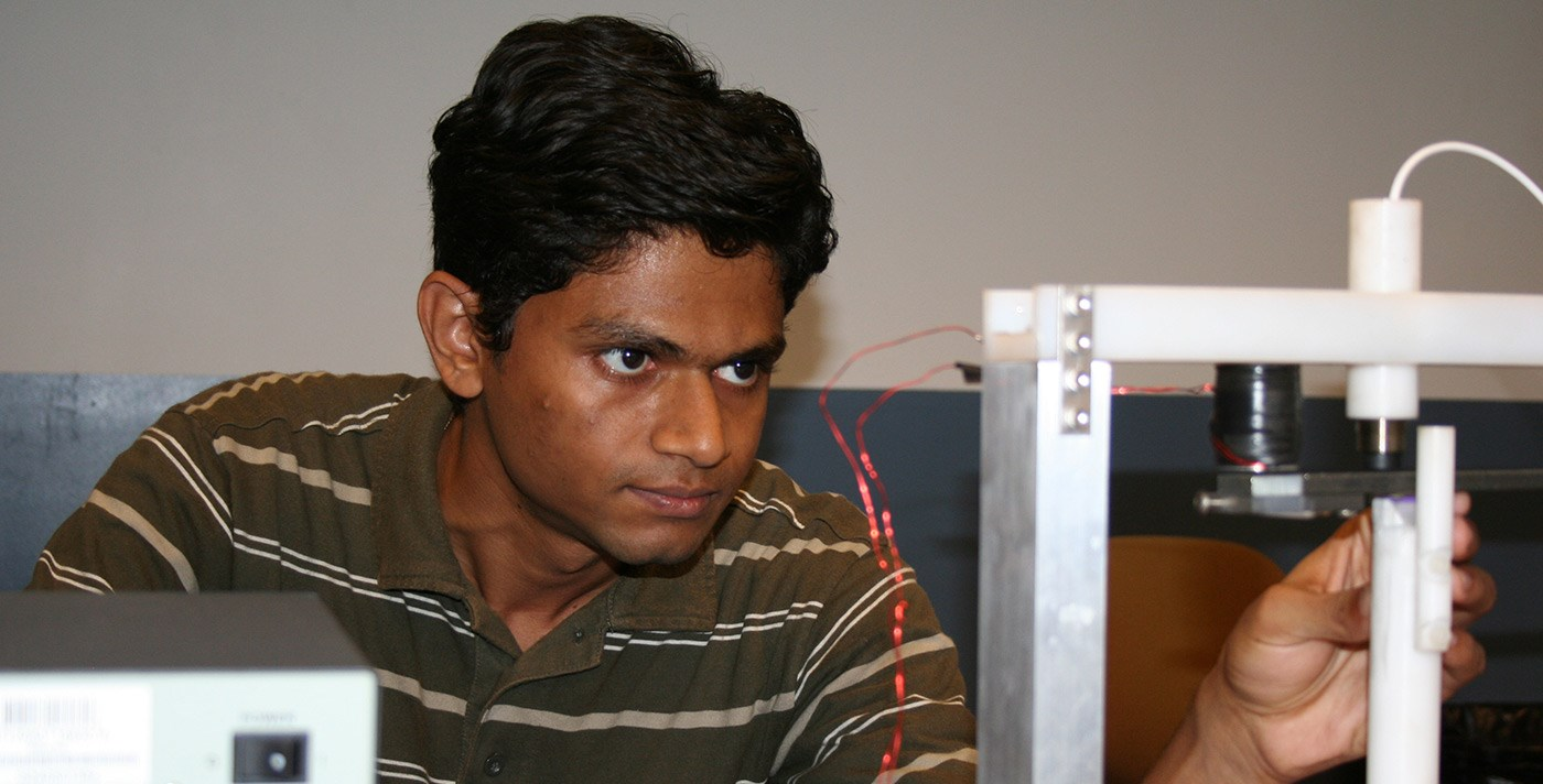 Electrical and Computer Engineering student working with unknown equipment