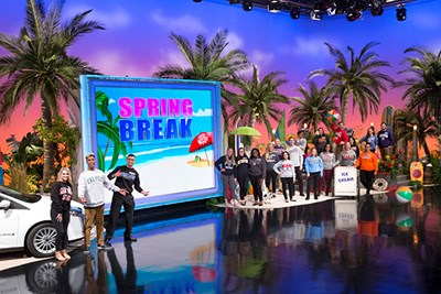 "UML honors student Mansour Chaya in a promo photo for ""Wheel of Fortune"" College Week Spring Break 2018"
