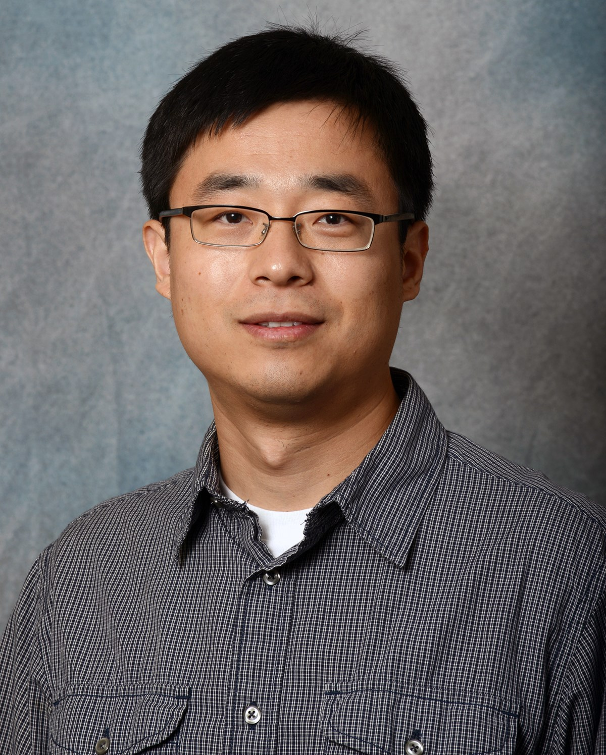 Zhu Mao faculty bio headhsot Photo