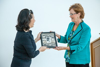 Jacquie Moloney presents Marjorie Yang with a framed photo