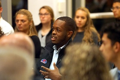 Student Ralph Saint Louis asks a question during the event
