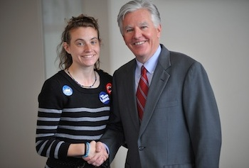 Chancellor Marty Meehan congratulates student Megan Lewis for spearheading the Ex-Smokers Hall of Fame project that aims to encourage people to kick the habit.