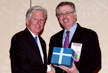 Chancellor Marty Meehan receives the CASE District I Chief Executive Leadership Award from Timothy Lawlor, CASE District I Board chairman and assistant vice president for development at Stonehill College, at the CASE District I/II conference in New York Jan. 23.