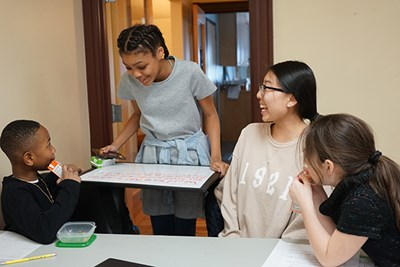 UML student Sofya Chow works with children at the CBA's after-school program