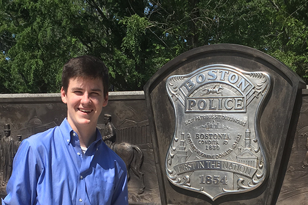 Mike Hanna poses in front of the Boston police department