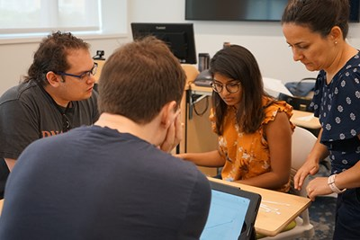 Neslihan Ocali, left, leads a supplemental instruction session for biology students including incoming transfer student James Yakura, left, and Sreya Nalla, a student at George Washington University taking the summer class at UML