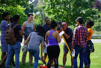 Assoc. Prof. Chronis Stamatiadis teaches Surveying I to a mix of UMass Lowell and Middlesex Community College students every summer. Helene Wambe, far left, is the supplemental instructor.