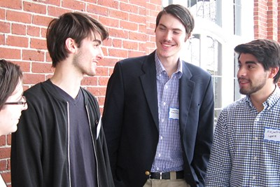 Alejandro Lopez and other UML Model UN team members at an event for former Ambassador to Spain James Costos