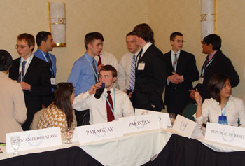 High school students at the Model U.N. Conference caucus to reach an agreement in committee.