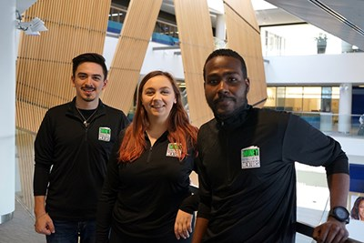 Mentors Luis Diaz, Jordan Jones and Steevens Pierre Tousssaint stand in University Crossing