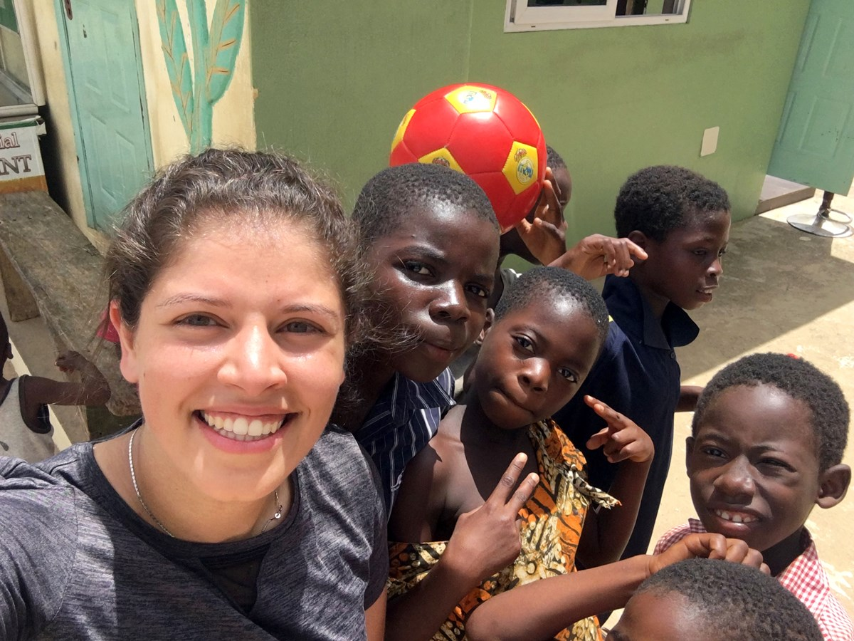 Monica Tawadros poses for a photo with children while on a two-week medical mission trip in Africa