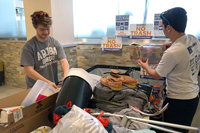 Student volunteers pick up donations at the ICC