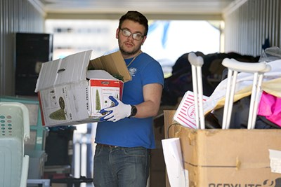 A student volunteer sorts donations on South Campus
