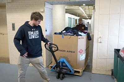 Michael Doherty pulls a pallet jack of donations at Catie's Closet