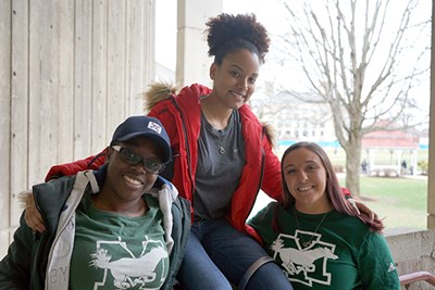Transfer students Chantay Sewell-Jones, Nicole Morales-Taveras and Jessica D'Esposito outside O'Leary Library