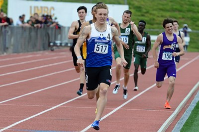 Junior Sean Munnelly sets record on track.