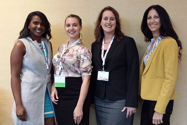 MBA students, from left, Ekaterina Soloveva, Raysa Mateo, Marcie Byrd and Lisa Passaretti take a break from networking at NAWMBA's annual conference and career fair in Stamford, Conn.