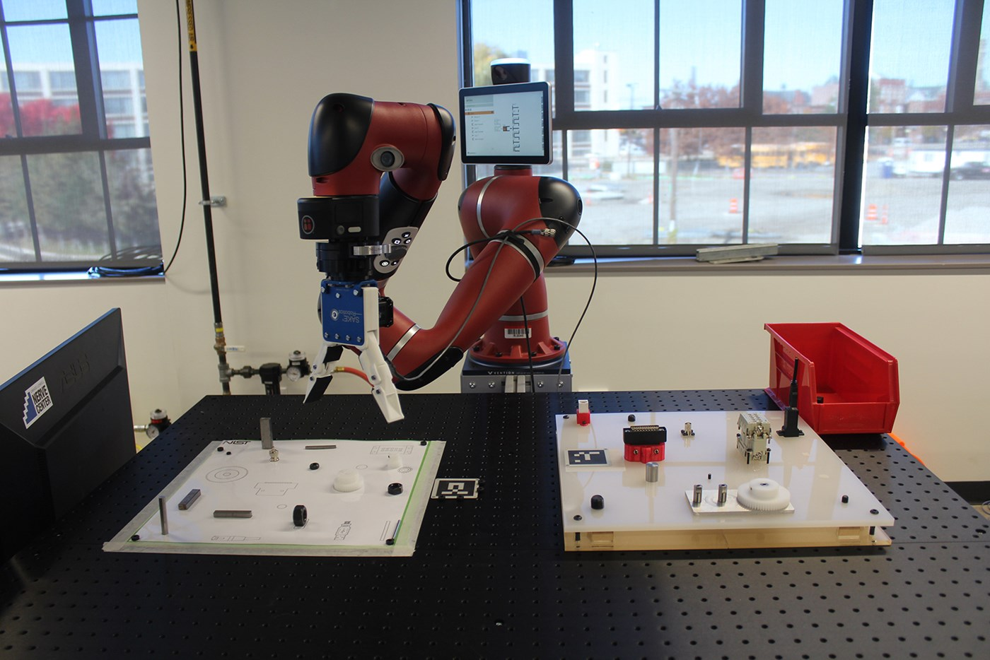 A Rethink Robotics Sawyer with SAKE Robotics EZ-Gripper